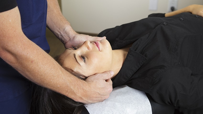 Chiropractor treating a female patient