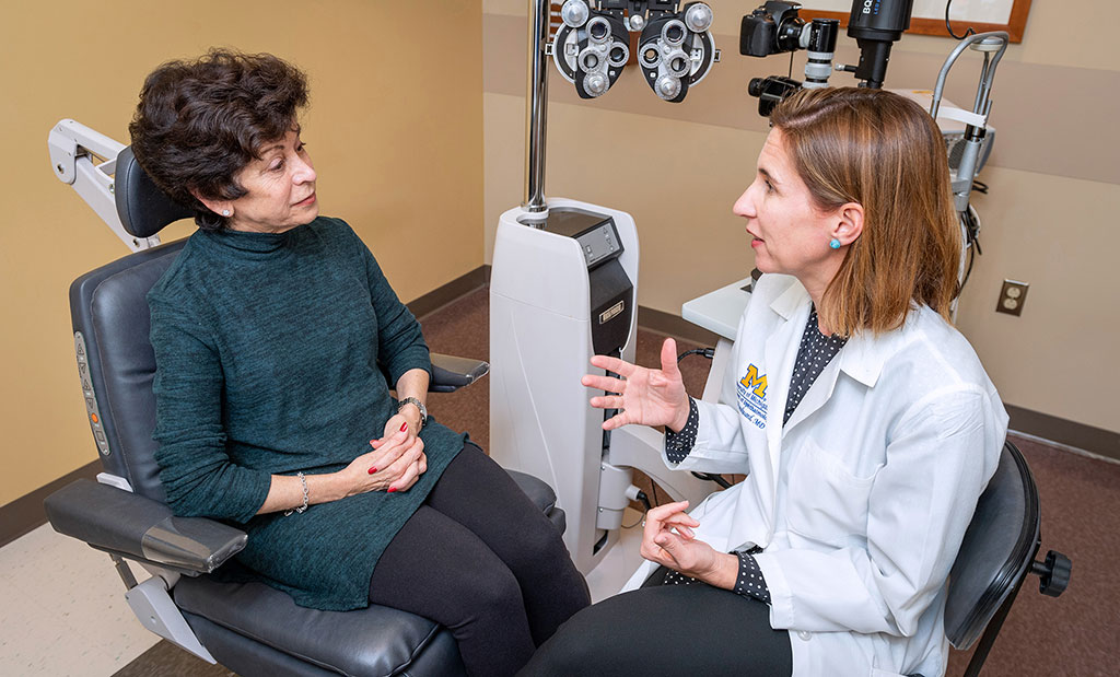 Cornea specialist, Dr. Maria Woodward, talks to a patient in an exam room