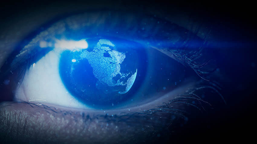 Pupil of an eye with world map being reflected in the eye