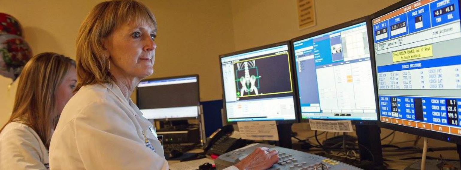 Radiation therapists at the controls