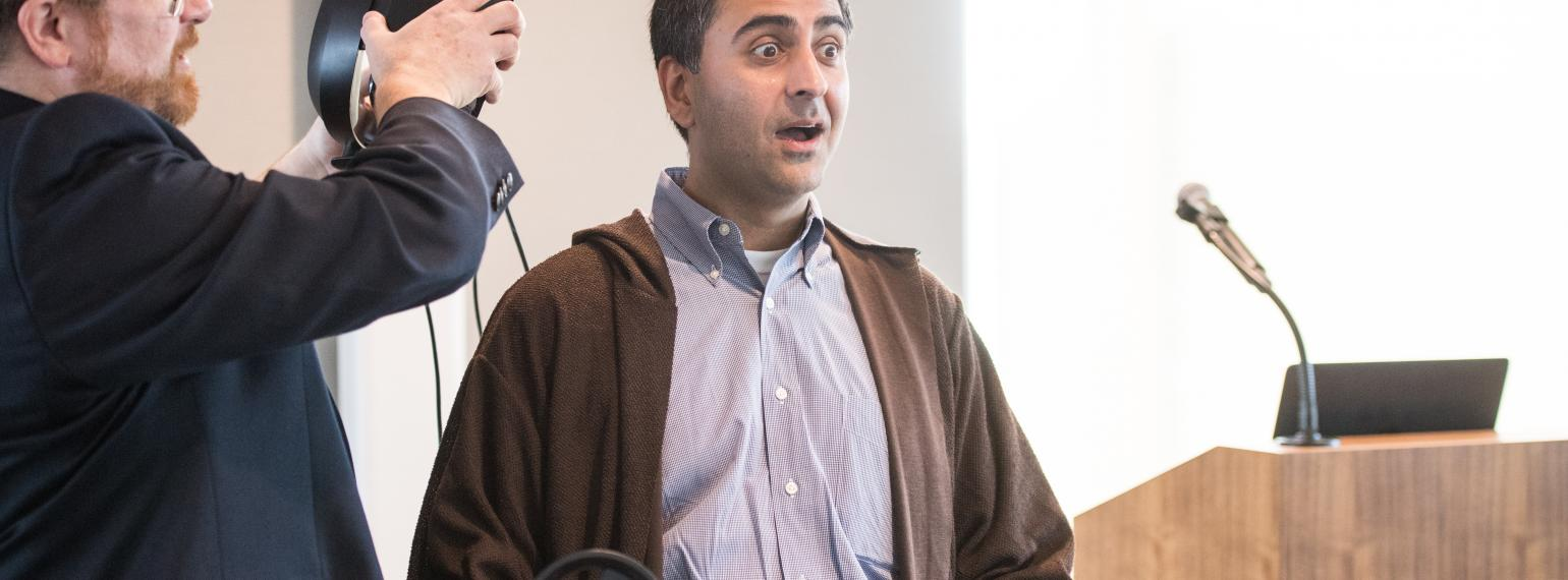 Dr. Rishi Bakshi with a shocked expression during James Rae Day
