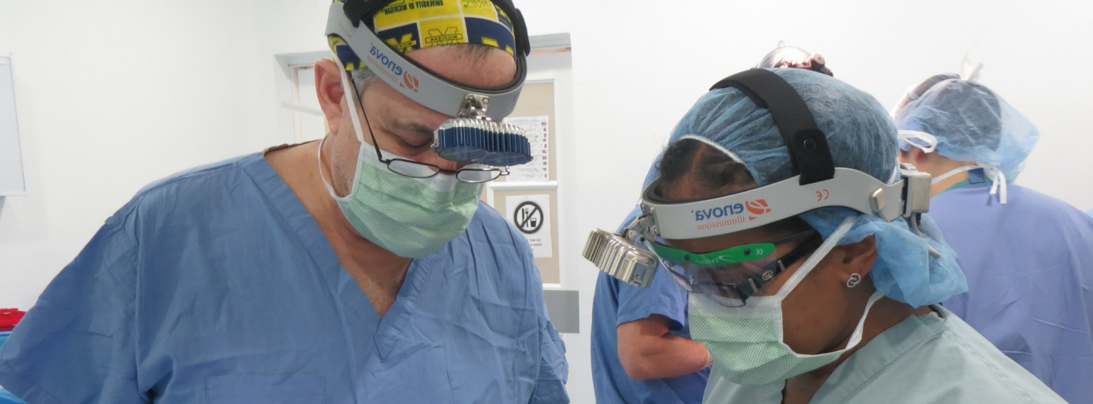 Dr. Gilman and Dr. Sears in an operating room in Colombia