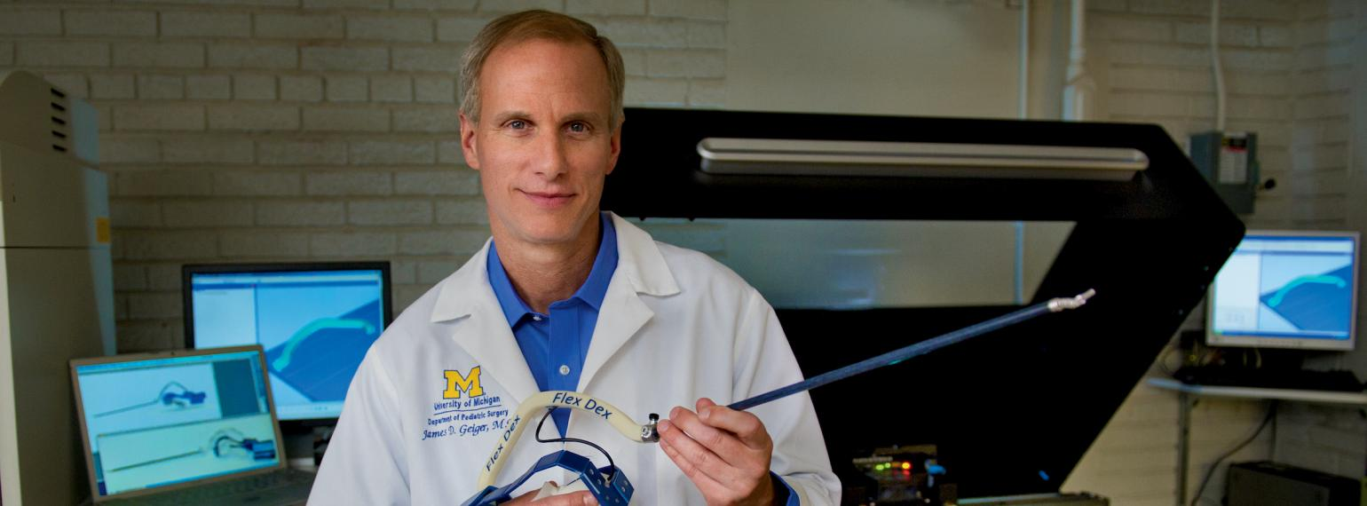 Dr. Geiger holding the FlexDex surgical device
