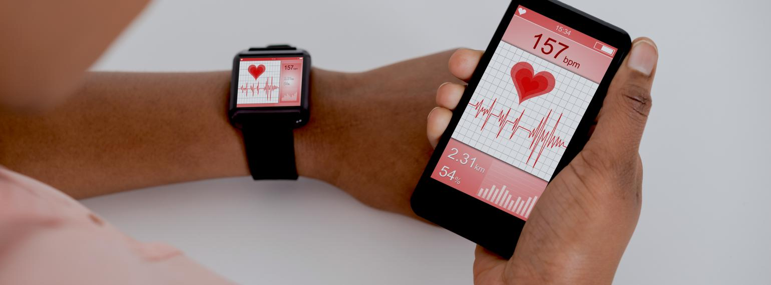 african american man checking heart rate app wearing smart watch