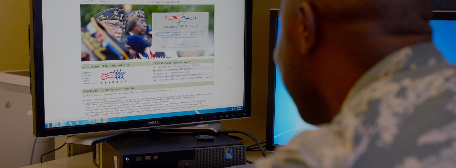 Man sitting at computer, looking at health care website