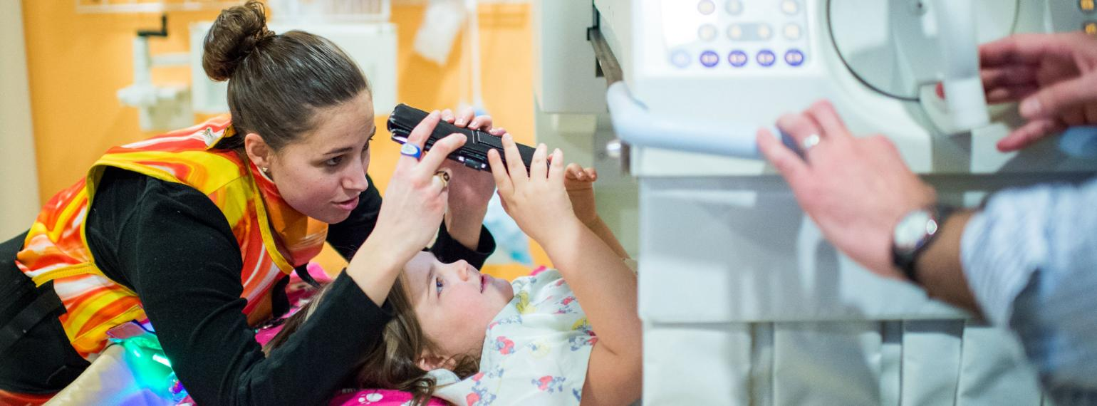 A healthcare worker comforts a young patient
