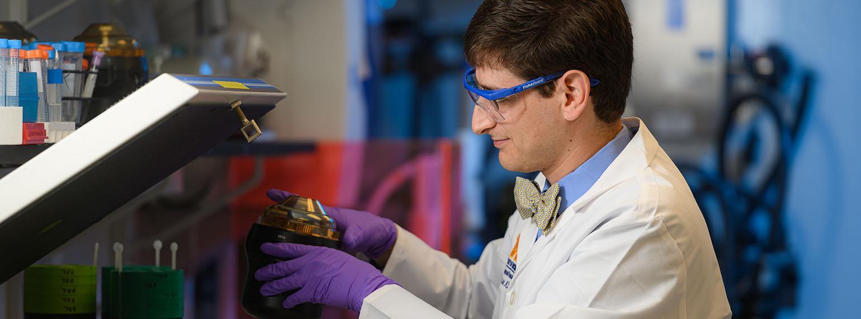 Lev Prasov, MD, PhD working in his lab