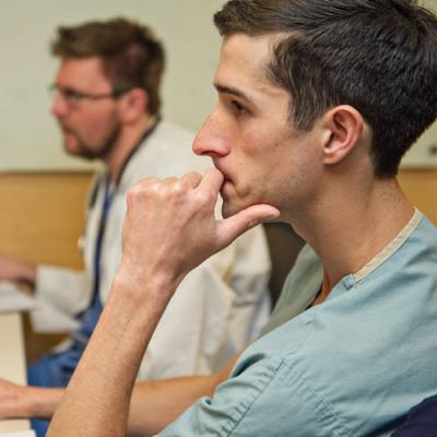 Emergency Medicine residents work on computers