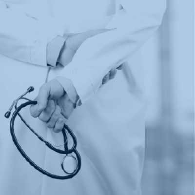 Healthcare provider holding stethoscope