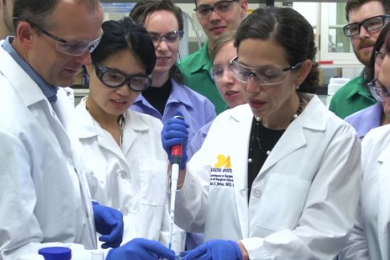 Dr. Jeruss in the lab with a team of lab members.