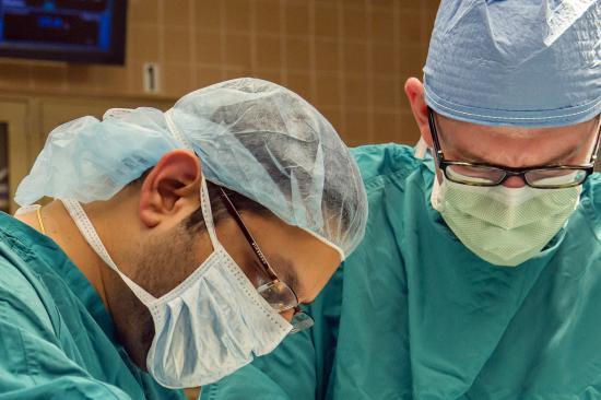 Dr. Englesbe and team member in the operating room