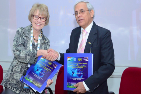 Mary Sue Coleman shaking hands with representative from All India Institute of Medical Science