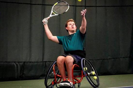 Matt Fritzie playing wheelchair tennis