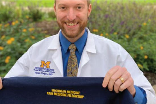 Ryan Hodges accepts his pain medicine fellowship