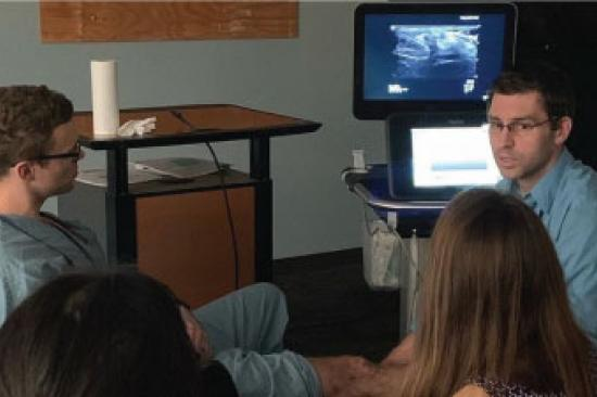 Residents discussing medical image on screen