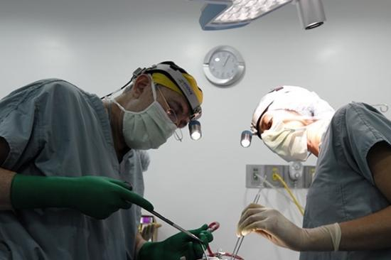 Dr. Gilman and team member in the operating room