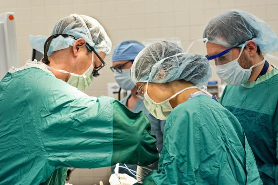 Dr. Hughes and surgical team in the operating room