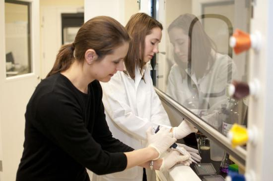 Dr. Obi and lab member working at Jobst Laboratories