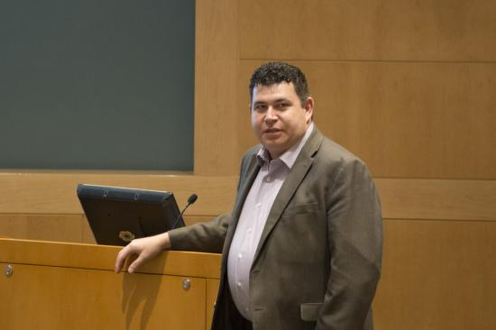 Dr. Cohen speaking at a podium