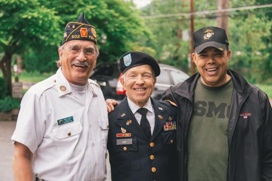 3 vets together, arm in arm
