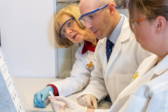 Dr. Eva Feldman, Dr. Stephen Goutman and Crystal Pacut looking at a sample from the ALS Center for Excellence Biorespository in the NeuroNetwork for Emerging Therapies lab