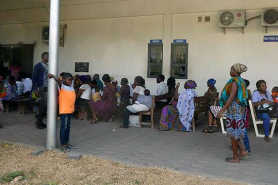 Crowd of people waiting for eye care in Ghana