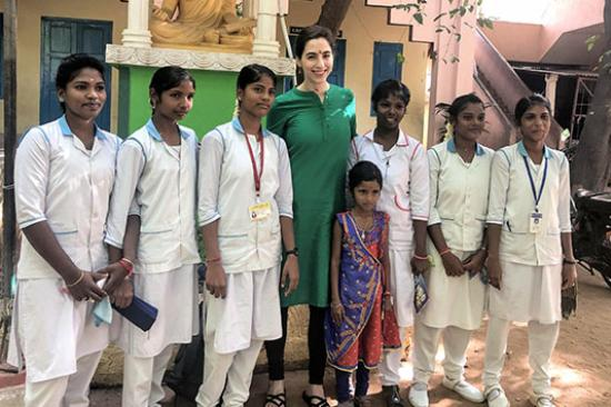 Emily Schehlein, MD, with students in India