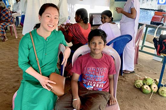 Visitor from University of Michigan with a child in India