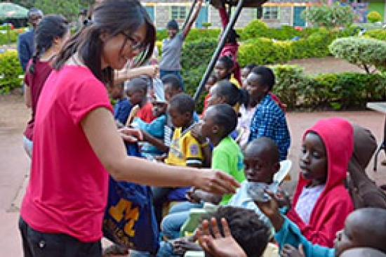 Dr. Sherry Day with children in Kenya