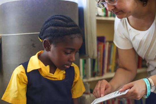 Dr. Donna Wicker with a young girl in Jamaica