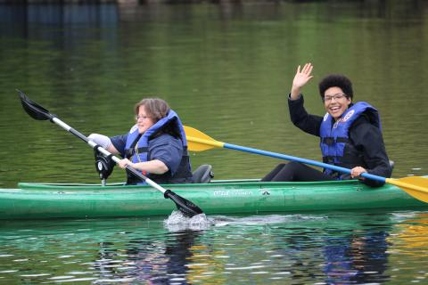 A UMAISE participant and a staff member kayaking