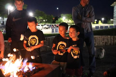 Roasting marshmallows during adaptive camping with UMAISE