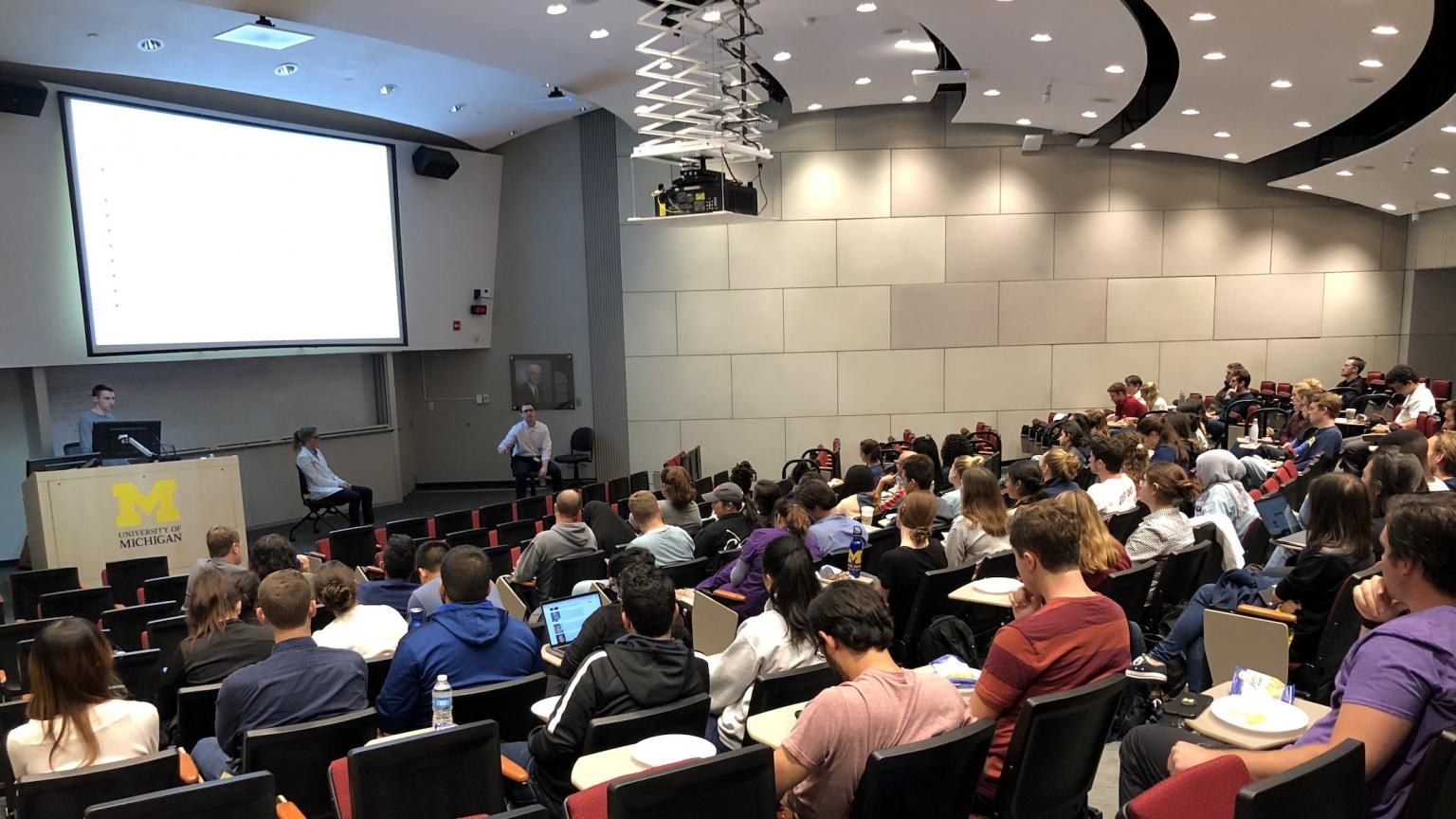 Students in auditorium attending the SCRUBS Welcome presentation