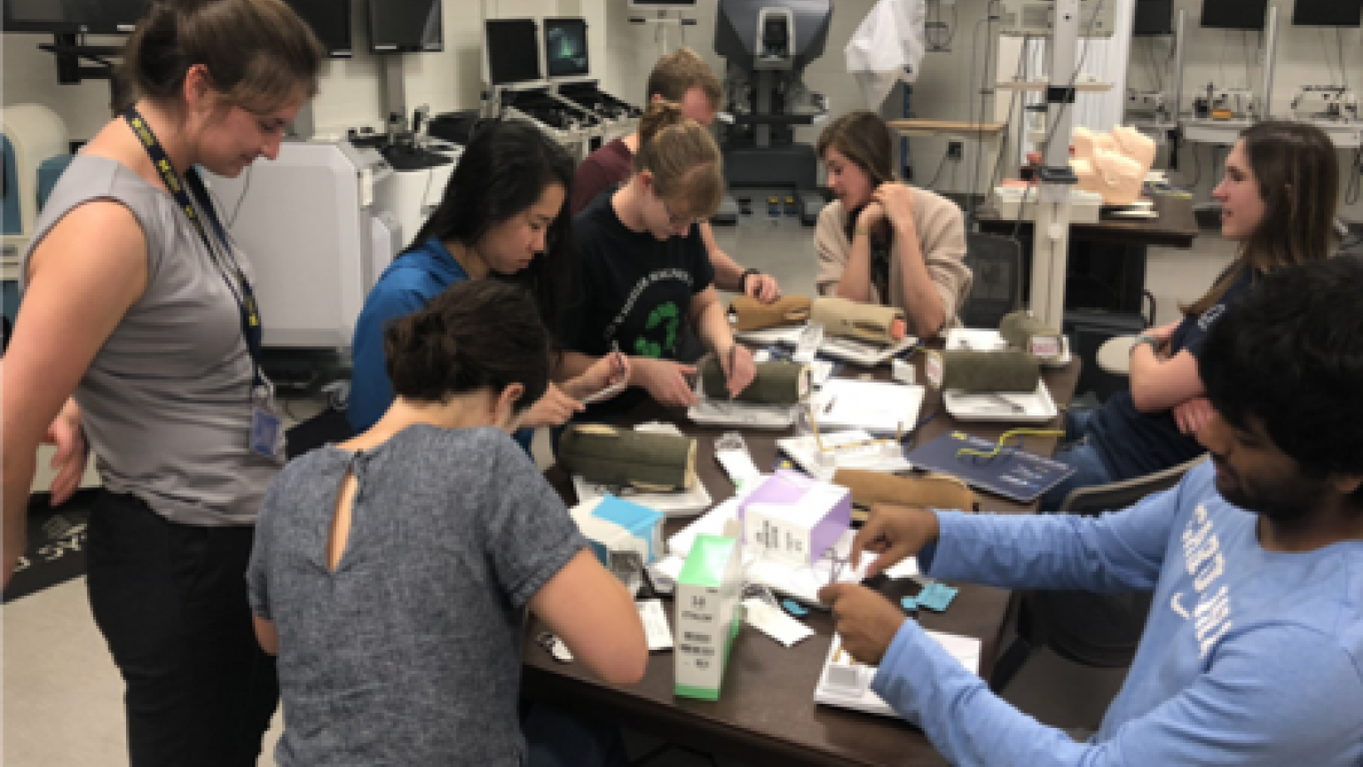 Students at table practicing surgical techniques