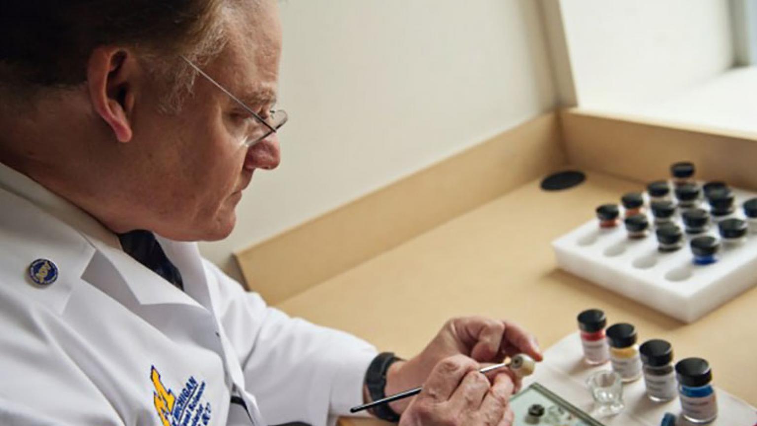 Ocularist Greg Dootz crafting an prosthetic eye
