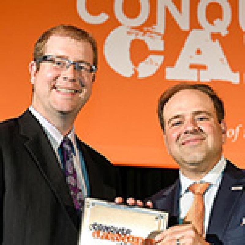 Dan Wahl, MD, PhD receiving research award