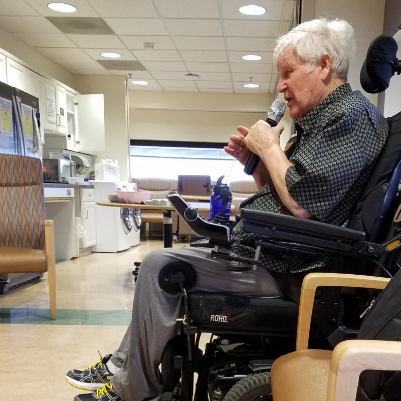 Carroll Knight Singing in Wheelchair