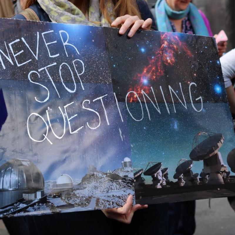 2017 March for Science sign that reads Never Stop Questioning