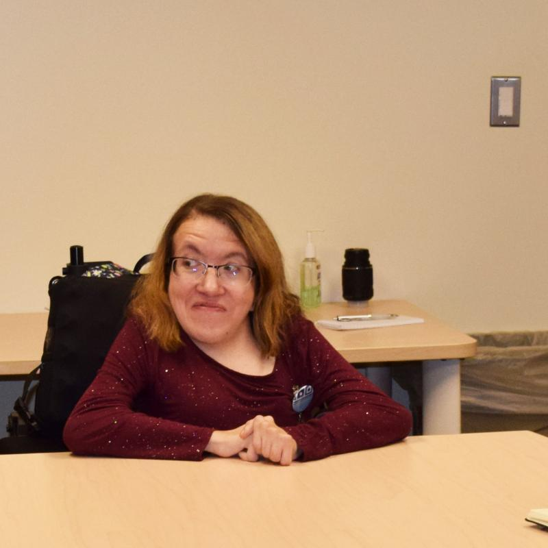 Rebecca Parten discusses disability accommodation issues with her legislators in a conference room.