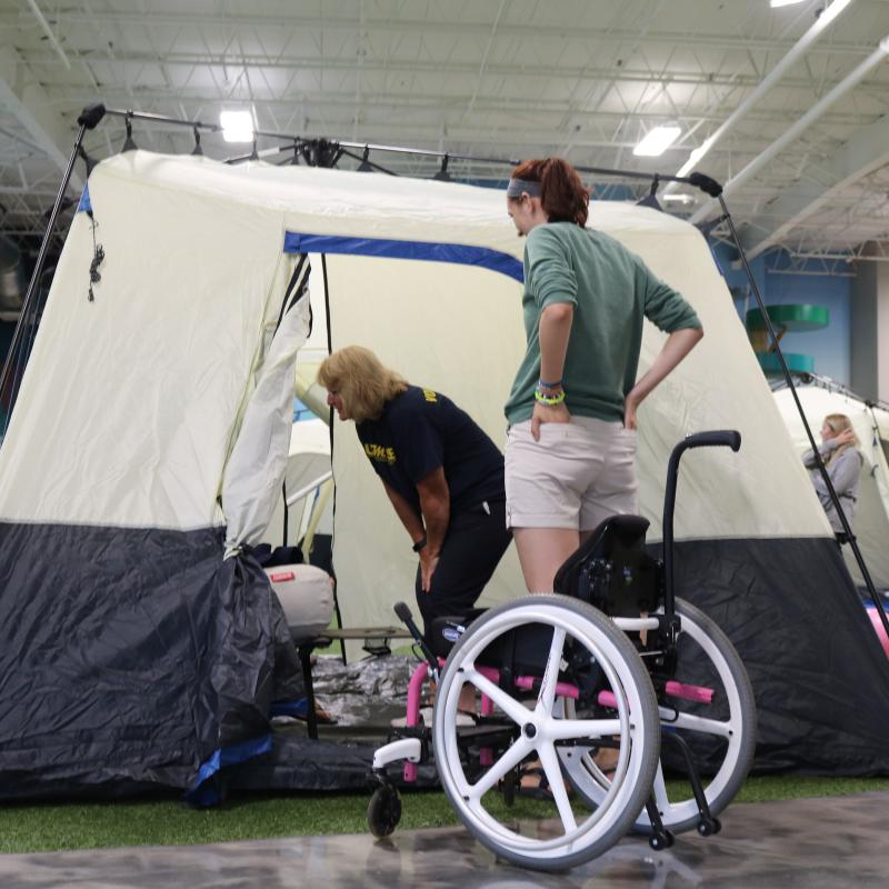 A wheelchair outside a tent at the UMAISE adaptive camp