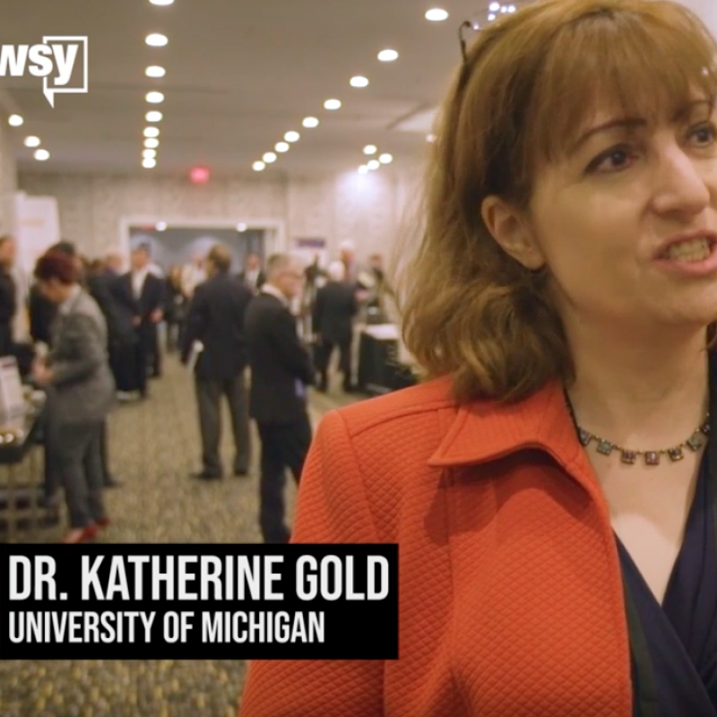 A screen capture of Dr. Katherine Gold speaking in the video. A Newsy logo appears in the top left corner.