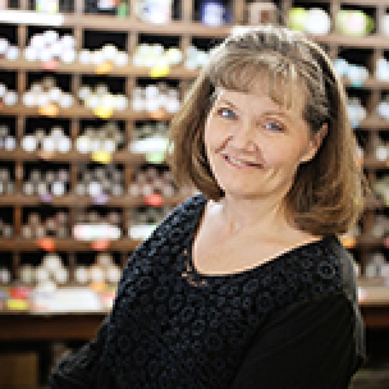 Art store owner Traci Lawson, standing in front of shelves of art supplies
