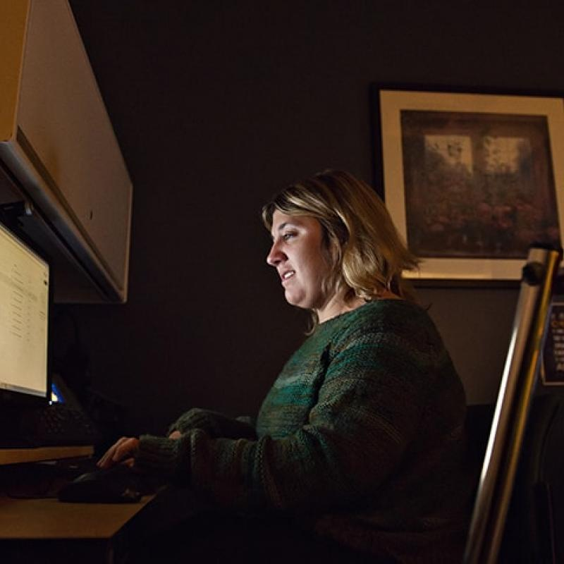 PM&R Researcher Jodi Kreschmer working at her desk