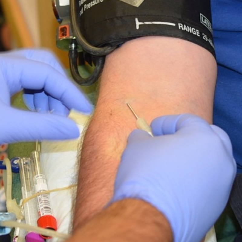 Close up of a man being prepped for a blood draw.