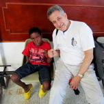 Dr. Gilman and a patient in Colombia