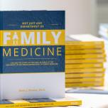 "A book entitled ""Not Just Any Department of Family Medicine"" standing on top of a stack of the same book."