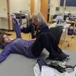 Stroke patient working with physical therapist in clinic
