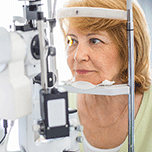 Older woman receiving an eye exam