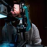 Man having a photo taken of his eye using a plenoptic camera