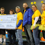 Students and staff from Lincoln Park High School presented a Gold Rush Grant to PM&R pediatric rehab fellow Alecia Daunter.
